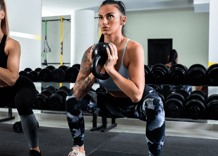 kettlebell squat Exercising with Kettlebells is the Best Way to Burn Fat!